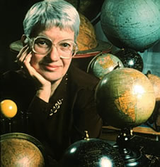 photo of Vera Rubin with an assortment of globes
