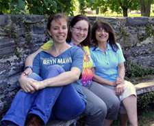 Annalisa Crannell (left) and her daughter Iolanthe Good (center), who were both recruited to the math major by Hughes (right)