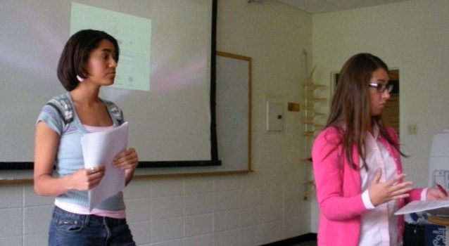 Alyssa Martin and Sasha Bereznak present their findings in Victor Donnay