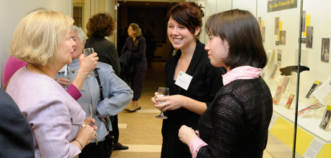 Alumnae and students chat at the opening of the Coombe Suite