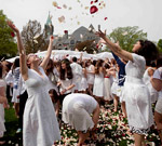 photo of students with flower petals