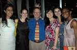 young alumnae pose with CFO John Griffith