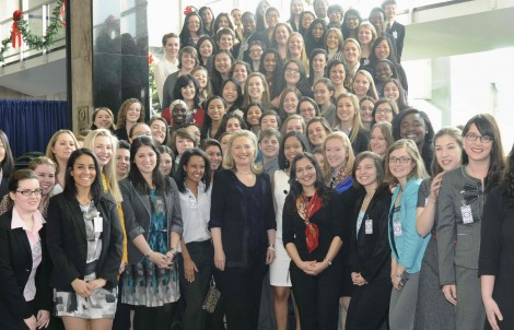 Secretary of State Hillary Clinton and students attending the Women in Public Service Project Colloquium. Clinton is flanked by Bryn Mawr students Meheret Shumet (left) and Jomaira Salas and Isel Otero-Vera (right)