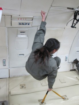 Christina Lee '12 holds on during her ride on NASA's reduced gravity aircraft