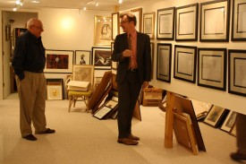 Howard Levine & Brian Wallace, curator and academic liaison for art and artifacts, in the Levines' home gallery before the collection's move