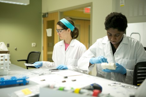 Clair Johnson '16 and Shakhari Badgett '17 at work in the geochemistry lab